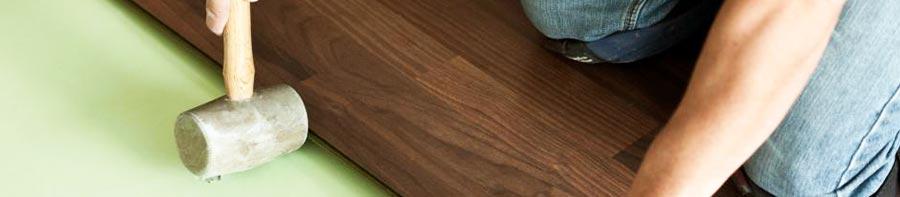 Handyman installing floorboards
